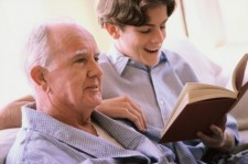 boy reading to recovering patient