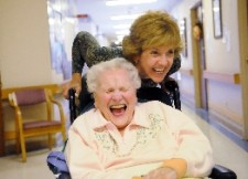 patient laughing during wheelchair ride