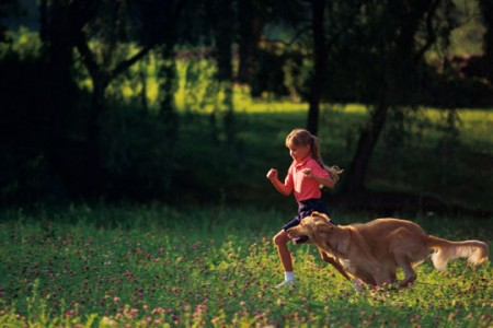 girl and dog running